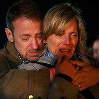 Jeff Hardy and Tania Scott embrace during a prayer vigil in Stratford, CT, the day after a mass shooting of 20 children and 7 adults at Sandy Hook Elementary School, in Sandy Hook, CT, on December 14, 2012.