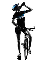 one caucasian cyclist woman cycling riding bicycle Drinking in silhouette isolated on white background
