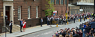 Crowds gather to watch Catherine Duchess of Cambridge and her husband Prince William leave the Lindo Wing with their new baby boy.