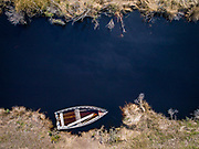 Aerial photo of a wooden skiff on a creek off the Albemarle Sound in Alligator River Wildlife Refuge.