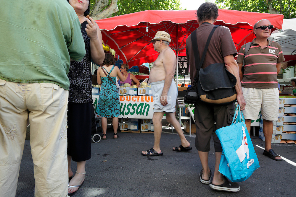 people at an outdoors regional farmers market