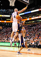 Feb. 4, 2012; Phoenix, AZ, USA; Charlotte Bobcats foward Boris Diaw (32) makes a pass around the Phoenix Suns center Marcin Gortat (4) during the first half at the US Airways Center. Mandatory Credit: Jennifer Stewart-US PRESSWIRE.