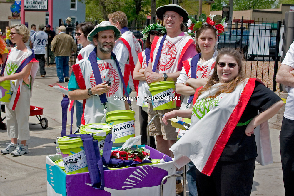 Mayday fund solicitors with buckets. In the Heart of the Beast May Day Festival and Parade Minneapolis Minnesota USA