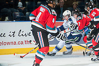 KELOWNA, CANADA - OCTOBER 7: Lucas Johansen #7 of Kelowna Rockets checks a player of the Swift Current Broncos on October 7, 2014 at Prospera Place in Kelowna, British Columbia, Canada.  (Photo by Marissa Baecker/Getty Images)  *** Local Caption *** Lucas Johansen;