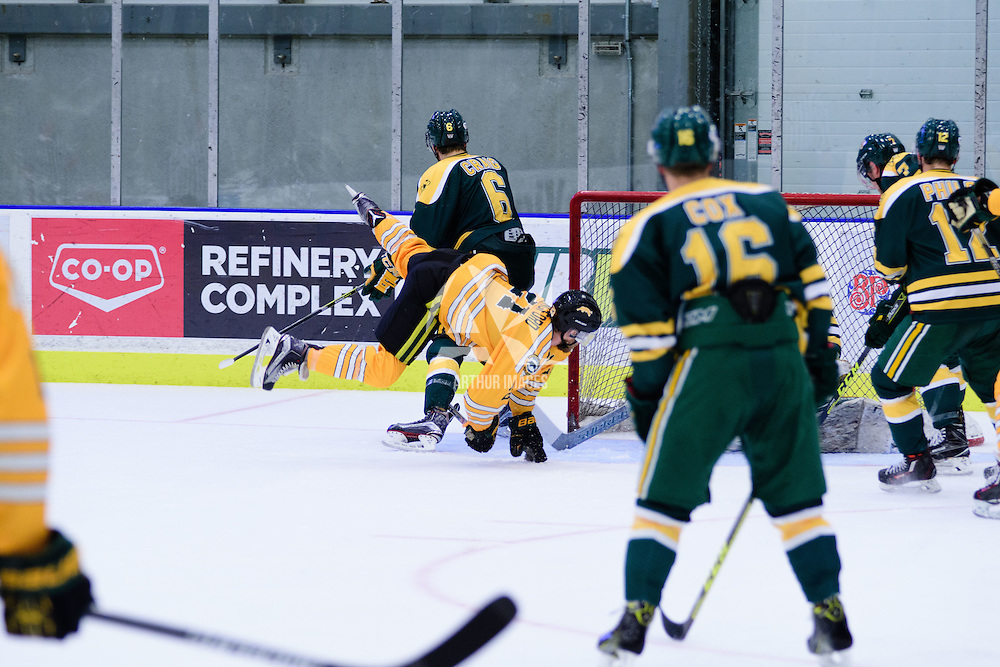 4th year forward Stephen Langford (21) of the Regina Cougars in action during the Men's Hockey Home Game on November 5 at Co-operators arena. Credit: Arthur Ward/Arthur Images