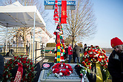 The memorial with wreath and scarves during the ceremony at Manchesterplatz, Munich, Germany. Picture by Phil Duncan.