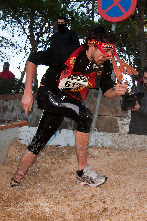 The Buff Epic Run is a crazy annual foot race that takes place on Montjuic in Barcelona. Most of the contestants dress in costumes and run through gauntlet of obstacles to reach the finish in the castle. It is almost as much fun to watch as it is to participate.