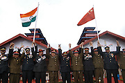 Indian and Chinese army put their hands together during the celebration of India's 60th Independence Day celebration in Bumla, at a hight of 15,000 in the Indo-China international border in Arunachal Pradesh, northeast India on Tuesday, August 15, 2006. An official deligation of Chinese officers and soldiers accompanied by their families joined in the Independence Day celebrations with their Indian counterparts. This event is a positive step towards further cementing the ongoing efforts for improving relationships between ancient civilizations, who are emerging as major partners in developing the Asian region.