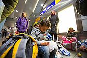 Frankfurt | Germany | 05.09.2015 : In der Nach vom 05. auf den 06. September kommen Fl&uuml;chtlinge mit Z&uuml;gen ins Rhein-Main-Gebiet oder haben hier einen Zwischenstopp auf dem Weg in andere Regionen. Ca. 100 Menschen aus verschiedenen Gruppierungen erwarten die Fl&uuml;chtlinge am Fernbahnhof des Flughafens. Fl&uuml;chtlinge aus einem Zug aus &Ouml;sterreich, die eigentlich bis Ingelheim durchfahren sollten, steigen am Flughafen aus und werden mit Hilfg&uuml;tern versorgt. Ein Teil der Gruppe entscheidet dann, in Frankfurt zu bleiben und wir von der Bundespolizei erfa&szlig;t und dann weiterverteilt.<br /> <br /> hier: Von der Flucht und Zugfahrt ersch&ouml;pfte Kinder<br /> <br /> 20150905<br /> Sascha Rheker<br /> <br /> [Inhaltsveraendernde Manipulation des Fotos nur nach ausdruecklicher Genehmigung des Fotografen. Vereinbarungen ueber Abtretung von Persoenlichkeitsrechten/Model Release der abgebildeten Person/Personen liegt/liegen nicht vor.] [No Model Release | No Property Release]