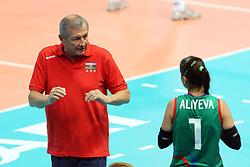 Azerbaijan coach Aleksandr Chervyakov talks to Azerbaijan Jeyran Aliyeva