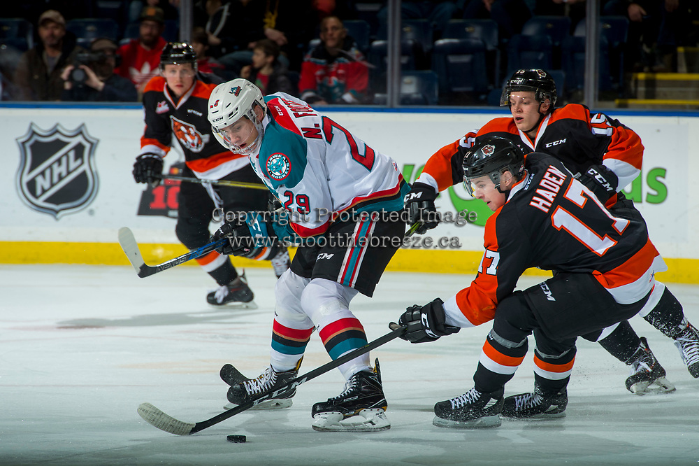 KELOWNA, CANADA - JANUARY 30: Gary Haden #17 of the Medicine Hat Tigers steals the puck from Nolan Foote #29 of the Kelowna Rockets on January 30, 2017 at Prospera Place in Kelowna, British Columbia, Canada.  (Photo by Marissa Baecker/Shoot the Breeze)  *** Local Caption ***