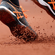 2017 French Open Tennis Tournament - Day Seven. The feet of Gael Monfils of France serving against Richard Gasquet of France during the Men's Singles round three match on Philippe-Chatrier Court at the 2017 French Open Tennis Tournament at Roland Garros on June 3rd, 2017 in Paris, France.  (Photo by Tim Clayton/Corbis via Getty Images)