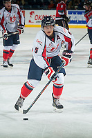 KELOWNA, CANADA - OCTOBER 11: Tyler Wong #5 of Lethbridge Hurricanes takes a shot during warm up against the Kelowna Rockets on October 11, 2014 at Prospera Place in Kelowna, British Columbia, Canada.   (Photo by Marissa Baecker/Shoot the Breeze)  *** Local Caption *** Tyler Wong;