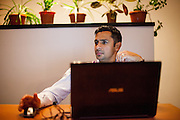 Portrait of Roma activist Marius Tudor working at home on his laptop. Marius is project manager for the Resources Center for Social Inclusion CRIS, focusing on organization and mobilization of the Roma communities.
