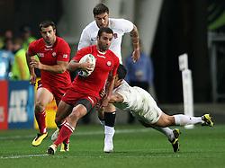 Romania's Merab Kvirikashvili tries to break through the Englands defence in the Rugby World Cup pool match at Otago Stadium, Dunedin, New Zealand, Sunday, September 18, 2011. Credit:SNPA / Dianne Manson.