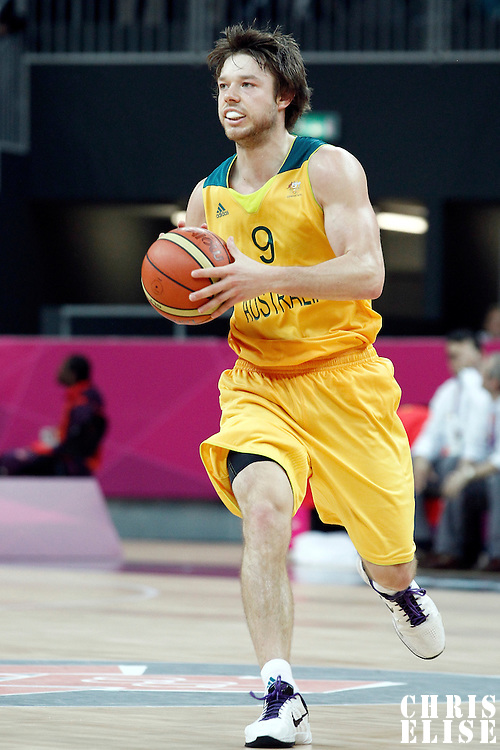 31 July 2012: Australia Matt Dellavedova passes the ball during the 82-70 Spain victory over Australia, during the men's basketball preliminary, at the Basketball Arena, in London, Great Britain.