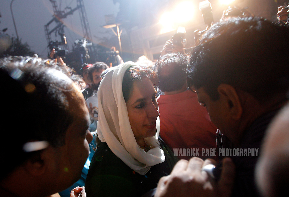 """LAHORE, PAKISTAN - NOVEMBER 12: Former Pakistani Prime Minister and head of Pakistan People's Party (PPP), Benazir Bhutto, arrives at the Lahore Press Club, on November 12, 2007 in Lahore, Pakistan. Bhutto announced that she has ended """"power-sharing"""" talks with Pakistani President, Pervez Musharraf, citing the state of emergency making talks impossible. Bhutto has vowed to go ahead with her planned rally from Lahore to Islamabad tomorrow, urging thousands of PPP members to join her. (Photo by Warrick Page)"""