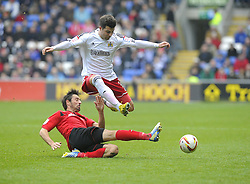 Cardiff City's Tommy Smith tackles Bristol City's Richard Foster - Photo mandatory by-line: Joe Meredith/JMP - Tel: Mobile: 07966 386802 16/02/2013 - SPORT - FOOTBALL - Cardiff City Stadium - Cardiff -  Cardiff City V Bristol City - Npower Championship