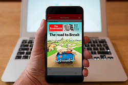 Using iPhone smartphone to display front page of The Economist current affairs newspaper