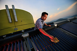 CHINA HONG KONG 24MAY10 - Sustainability officer Calvin Lee Kwan maintains a pilot solar thermal water heating installation at Hong Kong's Science and Technology University.<br /> <br /> jre/Photo by Jiri Rezac / The Climate Group<br /> <br /> © Jiri Rezac 2010