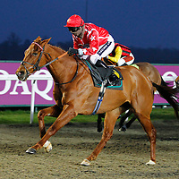 Victorian Number and Hayley Turner winning the 6.15 race