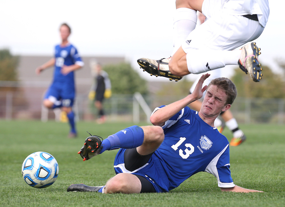 Hamilton Southeastern's Sean Larkin slides for the ball against Noblesville during soccer sectionals Saturday October 12, 2013 in Noblesville. Noblesville won the match 1-0. <br /> <br /> Chris Bergin/ for The Star