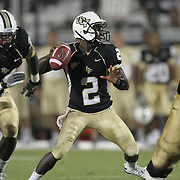 Central Florida quarterback Jeff Godfrey (2) passes the ball during an NCAA football game between the Boston College Eagles and the UCF Knights at Bright House Networks Stadium on Saturday, September 10, 2011 in Orlando, Florida. (AP Photo/Alex Menendez)