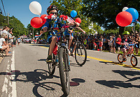 Bicycle riders from Gilmanton School were all decked out  in red, white and blue for the 4th of July parade on Wednesday morning.  (Karen Bobotas/for the Laconia Daily Sun)