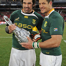 Pierre Spies and Victor Matfield of South Africa with the 2009 Lions Series Trophy during the British and Irish Lions tour 2009