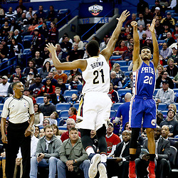 Dec 8, 2016; New Orleans, LA, USA;  Philadelphia 76ers guard Timothe Luwawu-Cabarrot (20) shoots over New Orleans Pelicans forward Anthony Brown (21) during the first quarter of a game at the Smoothie King Center. Mandatory Credit: Derick E. Hingle-USA TODAY Sports