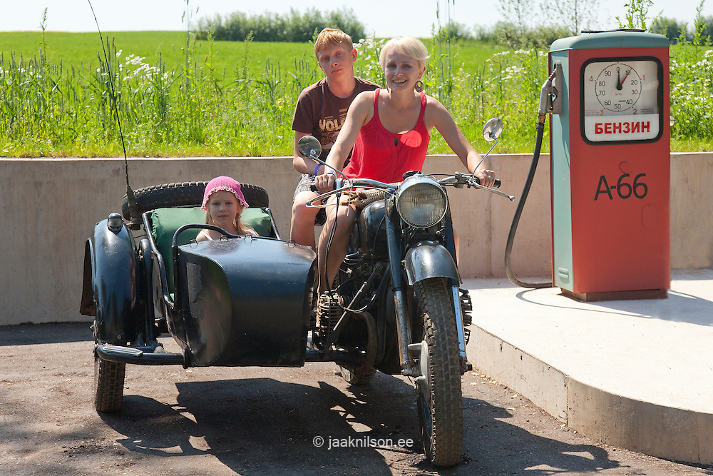 Family on Old Sidecar Motorcycle in Gas Station, Estonian Road Museum, Põlva County