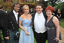 Left to right, NEIL MURRAY,  J K ROWLING, PETER KAY and his wife SUSAN at the Raisa Gorbachev Foundation fourth annual fundraising gala dinner held at Stud House, Hampton Court, Surrey on 6th June 2009.