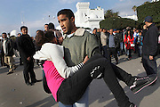 A young girl fainted in the crowd is carried to the hospital. Tunisians from province camp under the the Prime Minister's office demanding the dissolution of the interim governement.