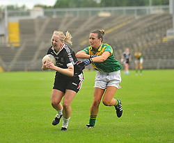 Sligo's Stephanie O'Reilly tries to get past Leitrim's Lorraine Brenna during  the Connacht Intermediate final in Castlebar on sunday last.<br /> Pic Conor McKeown