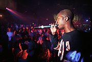 Man with a microphone at a rave, club u.n, 1996