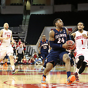 Rayvonte Rice #24 of the Illinois Fighting Illini goes up for a breakaway layup during the NIT First Round game at Agganis Arena on March 19, 2014 in Boston, Massachusetts . (Photo by Elan Kawesch)