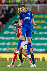 Michael Carrick of Manchester United and Peter Crouch of Stoke City compete in the air - Photo mandatory by-line: Rogan Thomson/JMP - 07966 386802 - 01/01/2015 - SPORT - FOOTBALL - Stoke-on-Trent, England - Britannia Stadium - Stoke City v Manchester United - New Year's Day Football - Barclays Premier League.