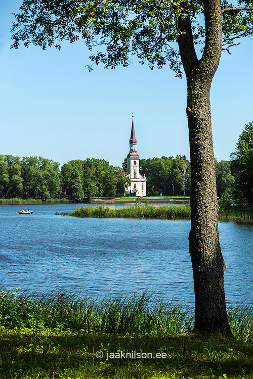 St. Michael's Lutheran Church in Räpina. Lake, grass and tree.