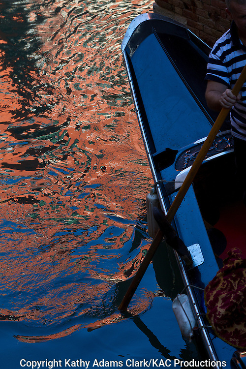 Reflections in the water on the canals of Venice, Italy.