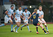 Racing 92 player ANTONIE CLAASSEN (R) comes towards Highlanders player JOSH RENTON (2nd R) with the support of his teammates (L to R MANUEL CARIZZA,MIKE PHILLIPS and LUC BARBA) during the Natixis Cup rugby match between French team Racing 92 and New Zealand team Otago Highlanders at Sui San Wan Stadium in Hong Kong.
