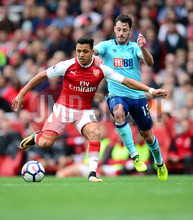 Alexis Sanchez of Arsenal battles for the ball with Adam Smith of Bournemouth - Mandatory by-line: Alex James/JMP - 09/09/2017 - FOOTBALL - Emirates Stadium - London, England - Arsenal v Bournemouth - Premier League