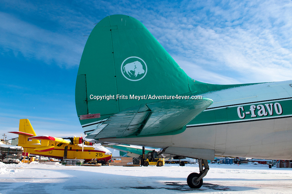 Yellowknife, Northwest Territories, Canada, February 2012. The Curtiss C-46 Commando is the workhorse of Bufallo Airways. The 1940's 1950's vintage transport aircraft of Buffalo Airways service the remote airstrips in the Arctic outposts and villages of Northern Canada. They have been immortalized by Ice Pilots NWT, the popular reality TV series. Photo by Frits Meyst/Adventure4ever.com
