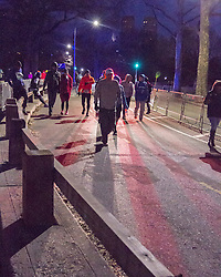 runners head for starting line in pre dawn darkness