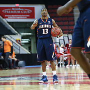 Tracy Abrams #13 of the Illinois Fighting Illini runs the offense during the NIT First Round game at Agganis Arena on March 19, 2014 in Boston, Massachusetts . (Photo by Elan Kawesch)