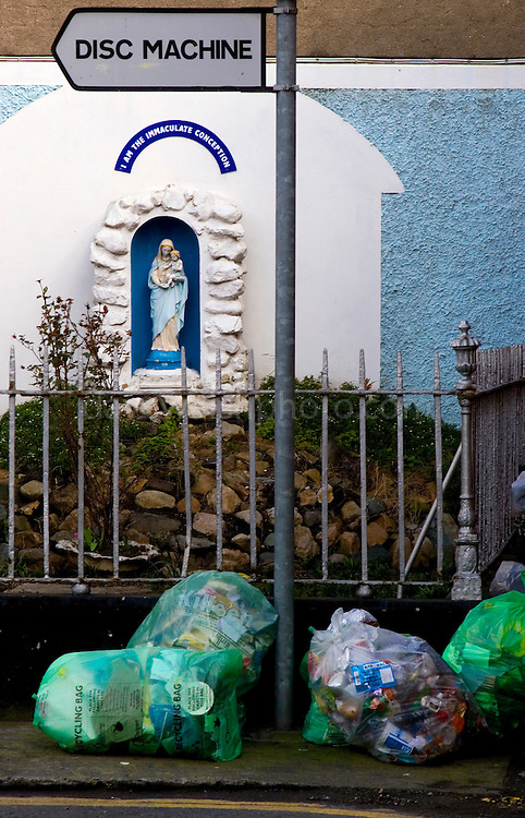"""In March 2008, the Vatican announced that """"environmental pollution"""" was a new deadly sin. I took this photograph last week, before this announcement - I realise now that the recycling bags have been left as offerings for the virgin mary.."""