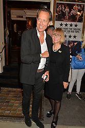 RICHARD E GRANT and his wife JOAN at the West End opening night of 'Great Britain' a  play by Richard Bean held at The Theatre Royal, Haymarket, London followed by a post show party at Mint Leaf, Suffolk Place, London on 26th September 2014.