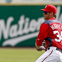 March 4, 2011; Viera, FL, USA; Washington Nationals right fielder Bryce Harper (34) during a spring training exhibition game against the Atlanta Braves at Space Coast Stadium. Mandatory Credit: Derick E. Hingle-US PRESSWIRE