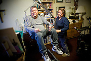 In Home Supportive Services (IHSS) caregiver Teresita Perez de Godoy, right, uses a lift to get quadriplegic Francisco Godoy out of his wheelchair in his Sacramento, CA home January 22, 2010. Francisco needs around-the-clock care from Teresita, his ex-wife who also lives with him. The state pays Teresita for 283 hours per month, at $10.40/hour. Gov. Schwarzenegger has proposed cutting or eliminating the IHSS program which provides care for 450,000 Californians and jobs for 375,000 caregivers. If the program was eliminated, most would need to be institutionalized, likely at far greater taxpayer expense. CREDIT: Max Whittaker for The Wall Street Journal.CABUDGET