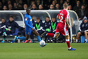 AFC Wimbledon defender Paul Osew (37) taking on Gillingham defender Barry Fuller (12) during the EFL Sky Bet League 1 match between AFC Wimbledon and Gillingham at the Cherry Red Records Stadium, Kingston, England on 23 November 2019.