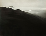 """Okada Koyo<br /> Title: The Peak at Morning from Asayo Peak<br /> Date: 1927<br /> <br /> Exceedingly rare, very early vintage print by Okada, one of his first views of Mt. Fuji<br /> <br /> Description: Very rare early print by Okada that survived his studio being destroyed in World War II. Glossy, gelatin silver print, near vintage, much different than most Okada prints printed on textured semi matte surface photo paper. This same photo was published in """"Mt. Fuji"""", by Okada Koyo, Hobundo Publishing, Tokyo, 1964, plate number 40. In this book, the caption reads:<br /> <br /> """"The Peak at Morning (from Asayo Peak, 2799 meters). Taken in the early morning of fall, 1927. This is a very old photograph made with Non-Panchro (Ilford Dry Plate, red label), which was popular among photographers at the time. The Equipment was a far cry from what is available today, but in a way was more suitable for producing the effect of a Japanese painting"""".<br /> <br /> Condition: Very good with deep rich tones and a trace amount of silvering on the edges. The print comes matted in an archival mat board.<br /> <br /> Size: 10 1/2 x 8 1/2 in. (267 mm x 216 mm). <br /> <br /> Price: ¥450,000 JPY<br /> <br /> <br /> <br /> <br /> <br /> <br /> <br /> <br /> <br /> <br /> <br /> <br /> <br /> <br /> <br /> <br /> <br /> <br /> <br /> <br /> <br /> <br /> <br /> <br /> <br /> <br /> <br /> <br /> <br /> <br /> <br /> <br /> <br /> <br /> <br /> <br /> <br /> <br /> <br /> <br /> <br /> <br /> <br /> <br /> <br /> <br /> <br /> <br /> <br /> <br /> <br /> <br /> <br /> <br /> <br /> <br /> <br /> <br /> <br /> <br /> <br /> <br /> <br /> <br /> <br /> <br /> <br /> <br /> <br /> <br /> <br /> <br /> <br /> <br /> <br /> <br /> <br /> <br /> <br /> <br /> <br /> <br /> ."""